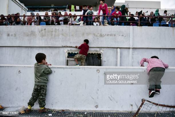 Children play during the celebrations of Nowruz the Persian New Year on March 21 2017 at the Hockey refugee camp situated at the former Olympic...