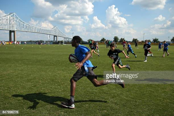 Children play flag football before the Aviva Premiership match between the Newcastle Falcons and the Saracens at Talen Energy Stadium on September 16...