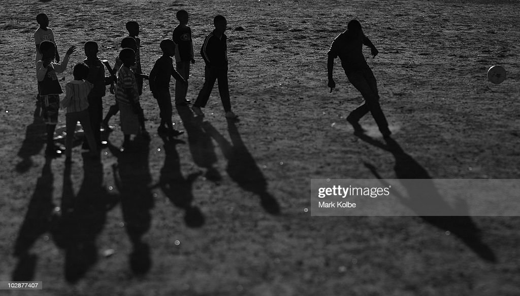 Children play football at Lawaaikamp township on June, 2010 in George, South Africa.