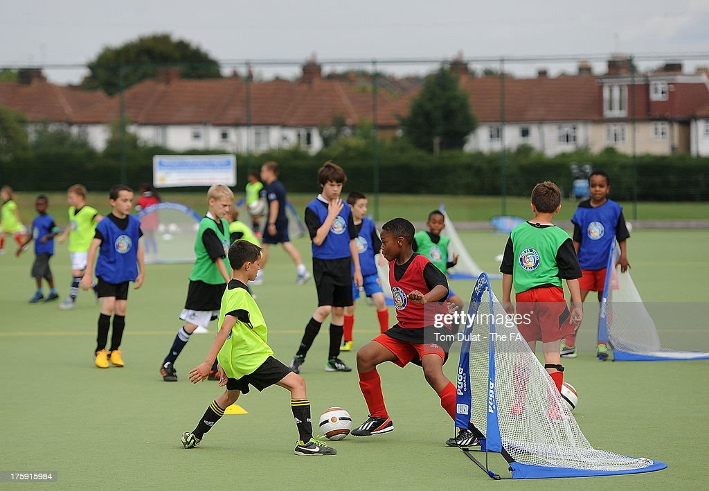Children play football during The FA's Sir Bobby Robson National Football Day at Kings College Sports Ground on August 10, 2013 in London, England.