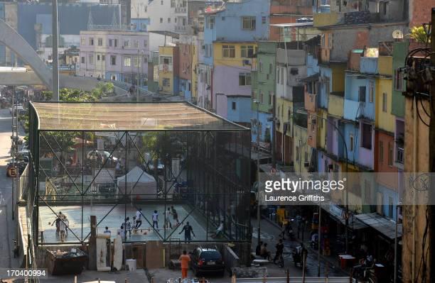 Children play football in a Favela on June 12 2013 in Rio de Janeiro Brazil