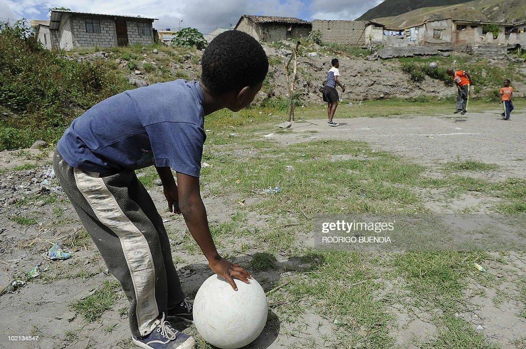 Children play football in Juncal, Valle del Chota, Ecuador, June 6, 2010.