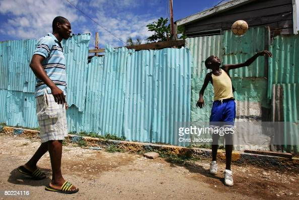 Children play football in Rose Town on March 12 2008 in Kingston Jamaica Kingston is currently a city with one of the highest crime rates in the...