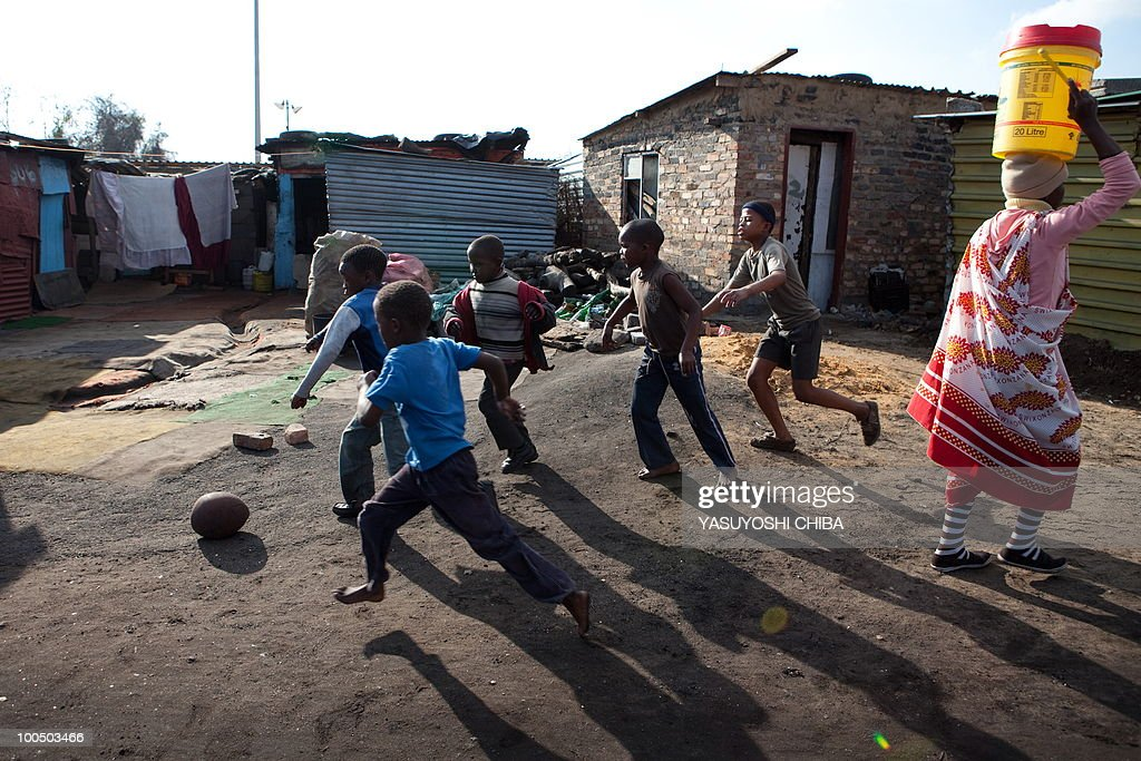 Children play football in Soweto on June 12, 2009 two days ahead of the opening match of the FIFA Confederations Cup in Johannesburg. A visit by President Jacob Zuma to inspect his troops on the eve of battle has given Confederations Cup hosts South Africa a huge boost ahead of Sunday's opener against Iraq, captain Aaron Mokoena said.