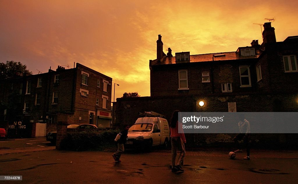 Children play football in the street as a spectacular sunset brightens up the sky on October 23, 2006 in London, England. According to the Met Office, it has been the warmest extended summer period on record with the first half of October seeing temperatures about 3 degrees celcius above average.