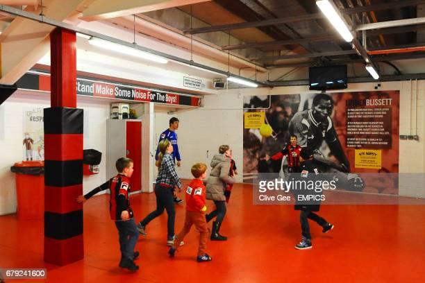 Children play football inside Dean Court
