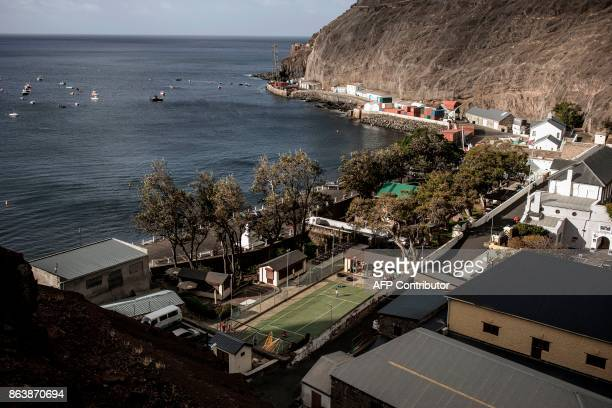 Children play football on a School sports ground by the city wharf on October 20 2017 in Saint Helena a British Overseas Territory in the South...