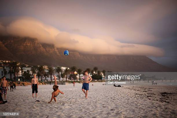 Children play football on the beach at Camps Bay on June 17 2010 in Cape Town South Africa