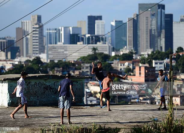 Children play football on the rooftops of a Favela on June 7 2013 in Rio de Janeiro Brazil