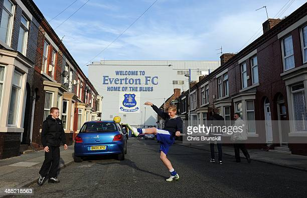 Children play football outside the stadium ahead of the Barclays Premier League match between Everton and Crystal Palace at Goodison Park on April 16...