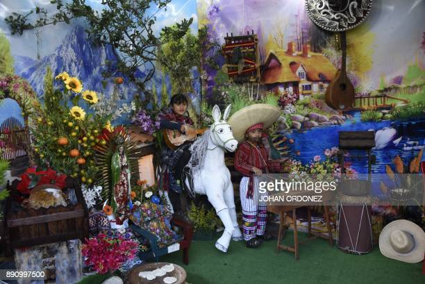 Children play guitar and marimba during the celebration of the apparition of the Virgin of Guadalupe to indigenous peasant Juan Diego in Mexico in...