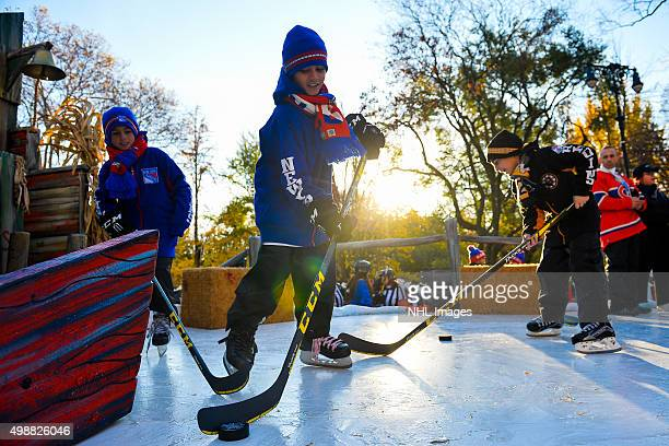 Children play hockey on the 2015 Discover NHL Thanksgiving Showdown float at the Macy's Thanksgiving Day Parade on Thursday November 6 2015 in New...