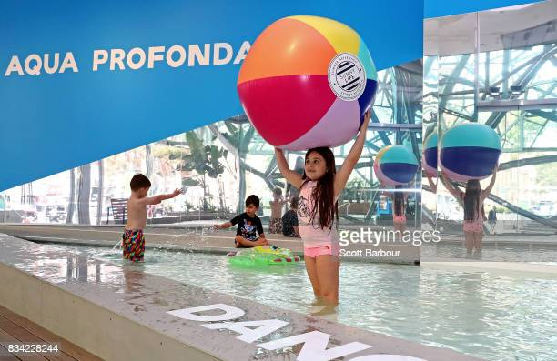 Children play in a 11 metre long swimming pool to celebrate the Australian premiere of The Pool exhibition at the National Gallery of Victoria...