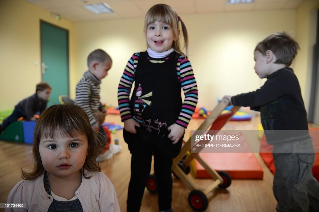 Children play in a creche of the Karapat association on February 8, 2012 in Lovagny. AFP PHOTO / PHILIPPE DESMAZES