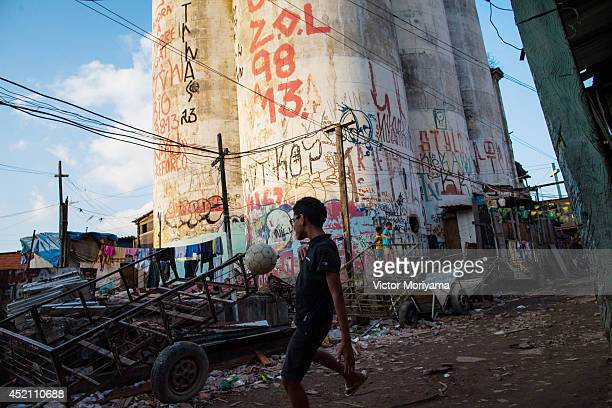 Children play in a football league organized by members of the 'popular committee for World Cup' in Favela do Moinho on July 13 2014 in Sao Paulo...
