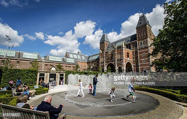 Children play in a fountain outside the Rijksmuseum in Amsterdam on May 17 2015 The Dutch Rijksmuseum museum was awarded the 2015 European Museum of...