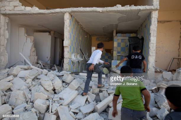 A'ZAZ ALEPPO SYRIA Children play in a MIG bombed out building in A'zaz Syria