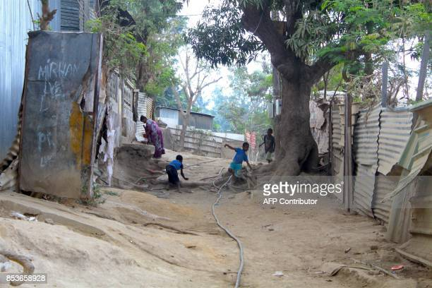 Children play in a street of La Vigie in PetiteTerre on the Mozambique channel French archipelago of Mayotte on September 22 as a census campaign is...