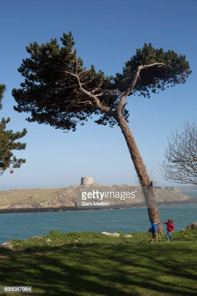 Children play in Dillons Park overlooking Dalkey Island on 08th April 2017 in County Dublin Republic of Ireland Dalkey is one of the most affluent...