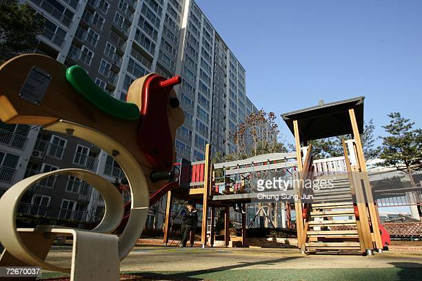 Children play in front of the Smart Homes complex is seen on November 29 2006 in Incheon South Korea The Home Network uses advanced technology to...