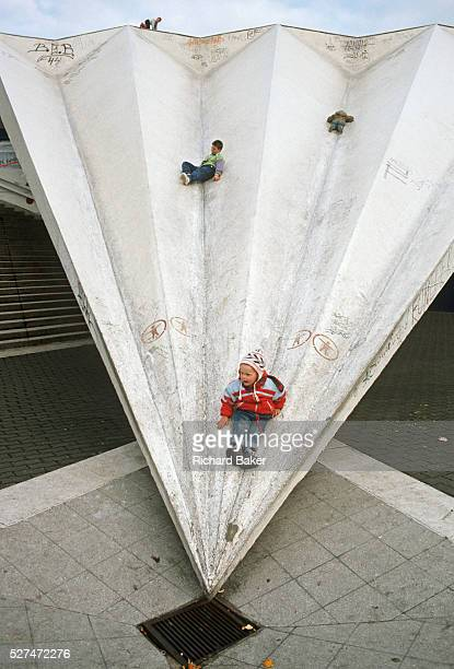 Children play in Marx Engels Platz on an East Berlin shopping precinct roof built during the Communist DDRera The youngsters use the sloping...