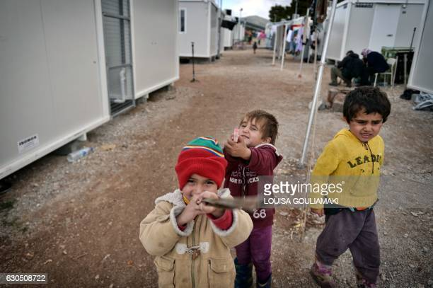TOPSHOT Children play in Ritsona refugee camp some 80 km north of Athens on December 21 2016 Before braving a 'trip of death' to escape Syria Talal...