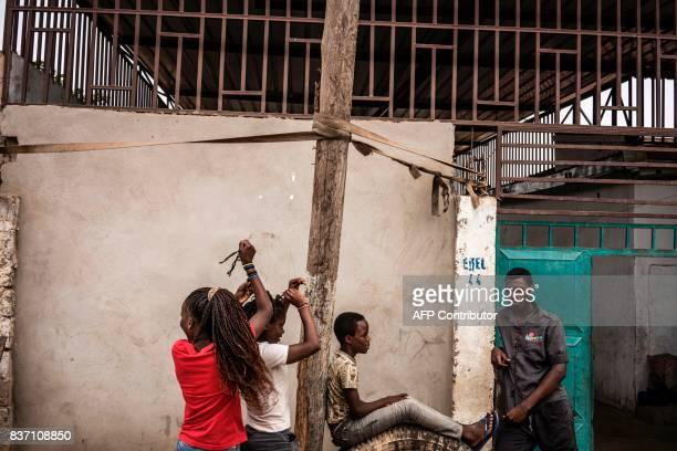 Children play in the alleys of the Viana district in Luanda on August 22 2017 With current president Dos Santos standing down after the election the...