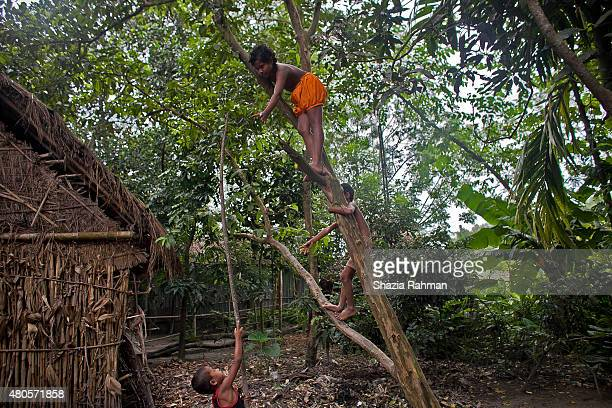 Children play in the Bash Kata Indian enclave July 9 2015 in Lalmonirhat District Bangladesh The India Bangladesh enclaves also known as the...