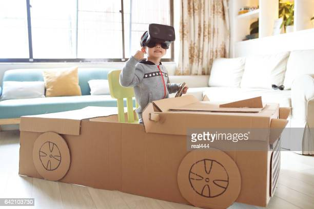 Children play in the cardboard car