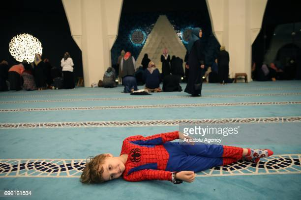 Children play in the Marmara University Theology Faculty Mosque as their mothers perform Tarawih prayer during Muslims' holy fasting month of Ramadan...