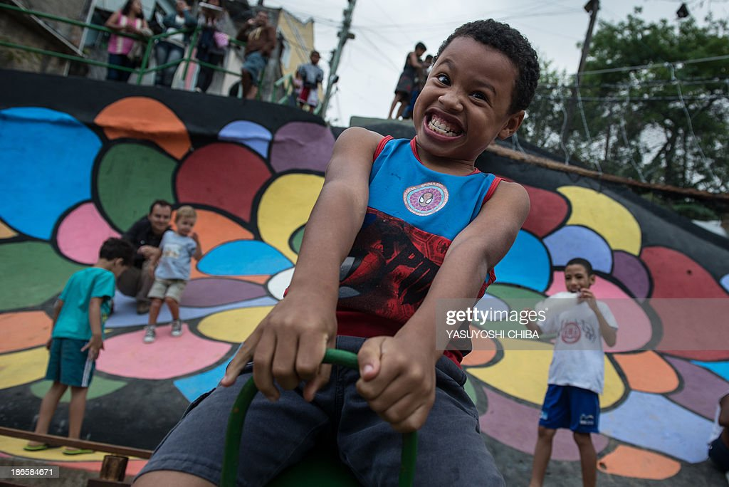 Children play in the newly inaugurated garden designed by French landscape gardener Stanislas Alaguillaume at Prazeres shantytown in Rio de Janeiro, Brazil, on November 1, 2013. The garden was made out ofa garbage pit and the community plans to turn all garbage pits into gardens.
