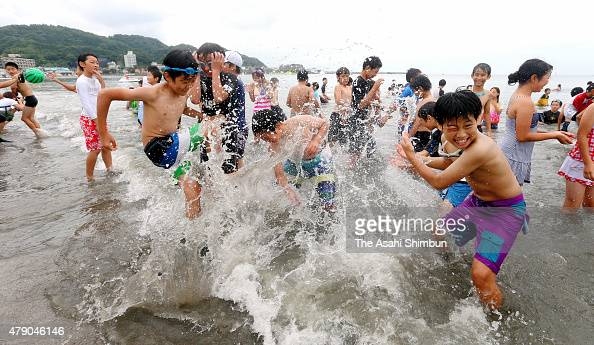 Children play in the sea as a beach opens on June 26 2015 in Zushi Kanagawa Japan