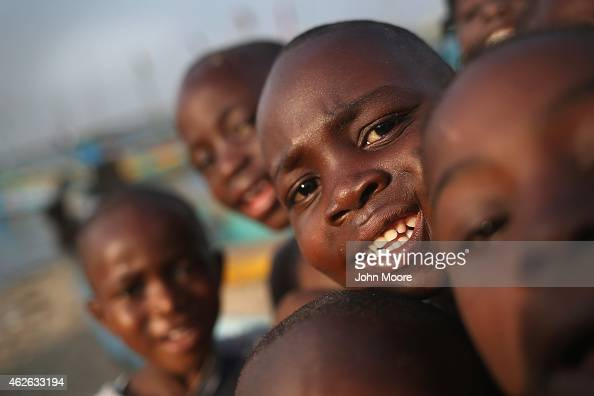 Children play in the West Point township on February 1 2015 in Monrovia Liberia Life has begun to slowly return to normal for many Liberians as the...