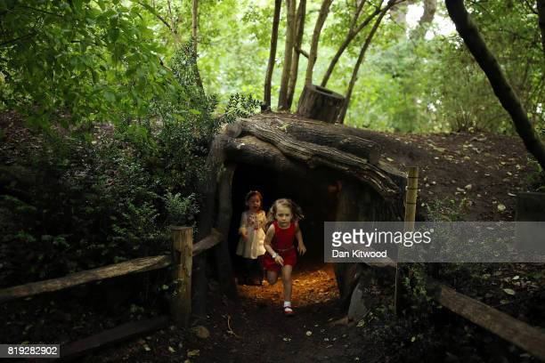 Children play inside an area designed to look like a badger set during a photocall at Kew Gardens on July 20 2017 in London England The Kew Gardens...