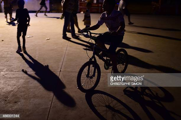 Children play near the stage of the BrazilianFrench 'Planeta Ginga' film and music free festival at the Cidade de Deus shantytown in Rio de Janeiro...