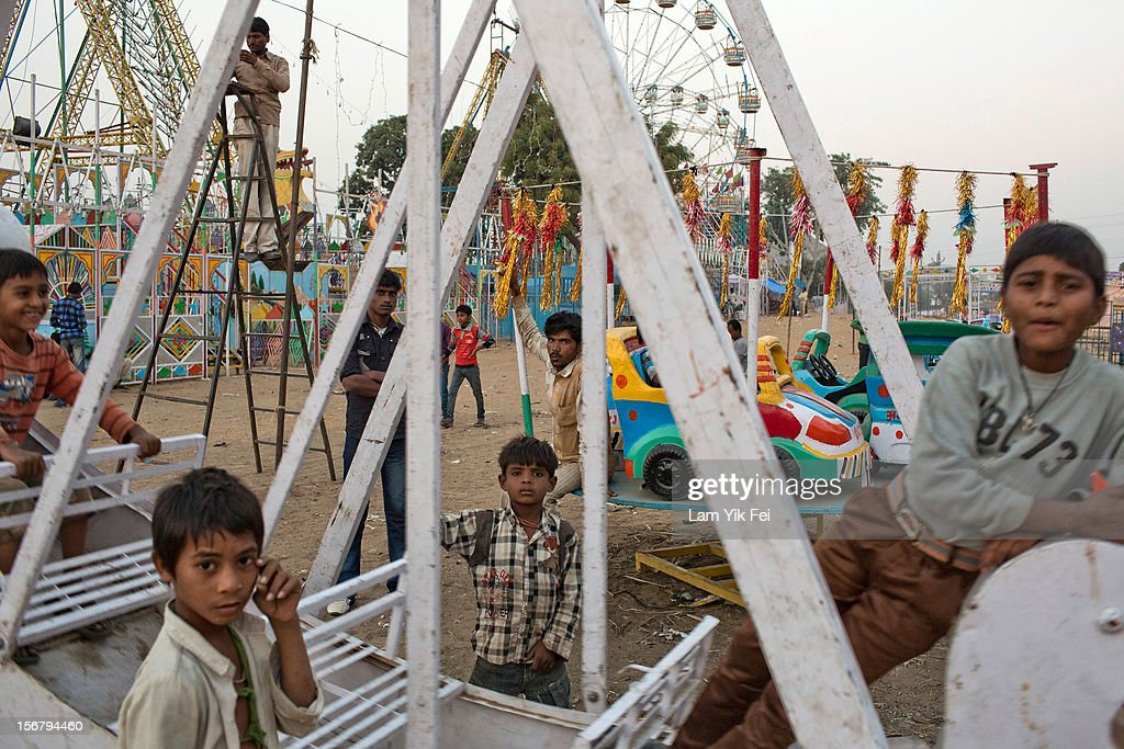 Children play on a carnival game during the Pushkar camel fair on November 21, 2012 in Pushkar, India. The annual camel and livestock fair is held over five days, and attracts thousands of tourists.
