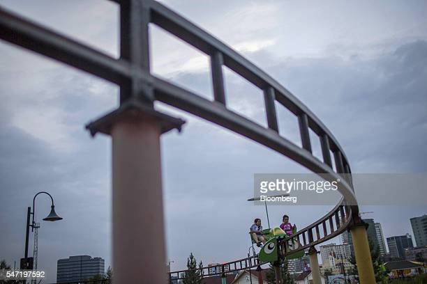 Children play on a carnival ride at the National Amusement Park known as the Children's Park in Ulaanbaatar Mongolia on Wednesday July 13 2016 The...