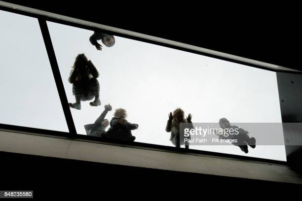 Children play on a glass roof at the new pound185m Giant's Causeway visitors' centre in County Antrim
