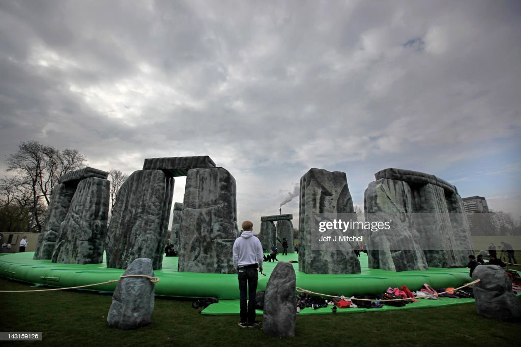 Children play on a new interactive artwork by Jeremy Deller as it is launched as part of the Glasgow International Festival of Visual Arts at Glasgow Green on April 20, 2012 in Glasgow, Scotland. Deller's Sacrilege is a full scale inflatable replica of Stonehenge, one of the UK's most recognisable heritage sites. The festival is showcasing more than 130 artists across 50 of Glasgow's permanent and temporary exhibition venues, with the 18 day programme featuring a series of newly commissioned works, several of which involve other disciplines, including dance, film, music, performance and theatre.