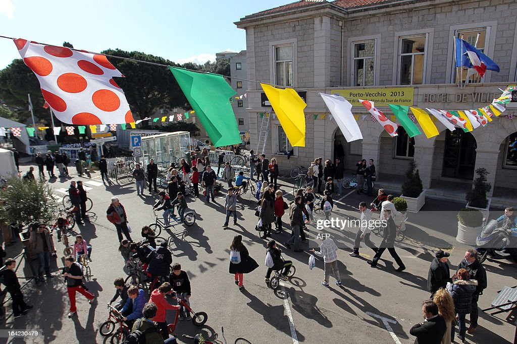 Children play on a Porto Vecchio square on March 21, 2013, a hundred days before the start ofthe Tour de France cycling race, which will start in Porto Vecchio, Corsica.