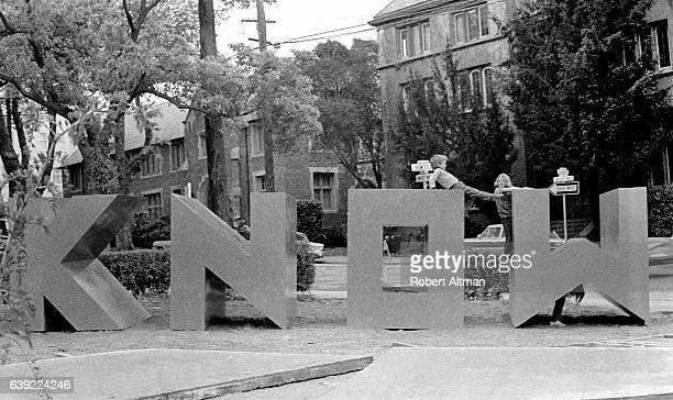 Children play on a sign that says 'Know' at People's Park circa May 1969 in Berkeley California
