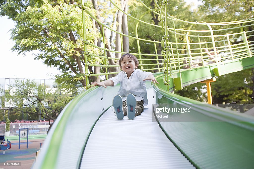Children play on a slide : Stock Photo