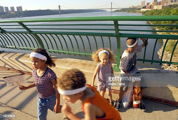 Children play on a spot overlooking the Hudson River July 31 2001 at Riverbank State Park in Harlem New York City
