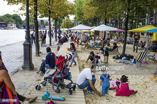 Children play on an artificial beach set on the banks of the Bassin de La Villette in Paris on August 24 on the last day of the 13th edition of...
