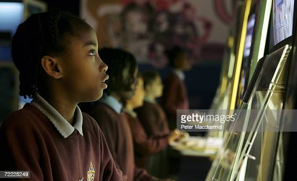 Children play on computer games at the Science Museum on October 20 2006 in London The Game On exhibition at the museum displays 120 classic and...