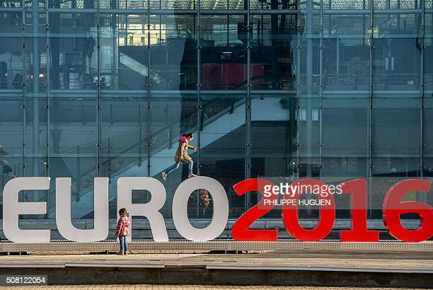 Children play on February 3 2016 around giant letters of the 'UEFA EURO 2016' in Lille where some of the Euro 2016 football matches will take place /...