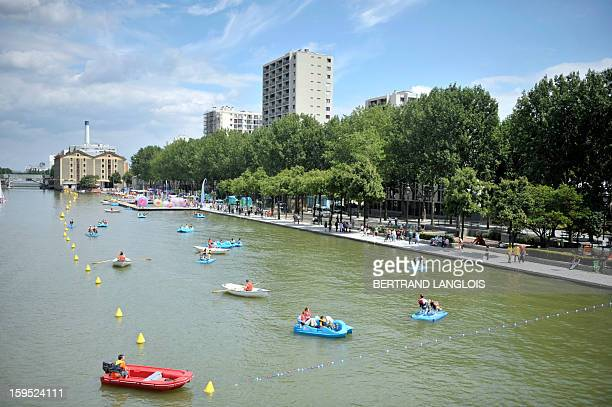 Children play on paddle boats on the Bassin de La Villette as part of 'Parisplage' event on July 24 2010 in Paris For the nineth summer Paris...