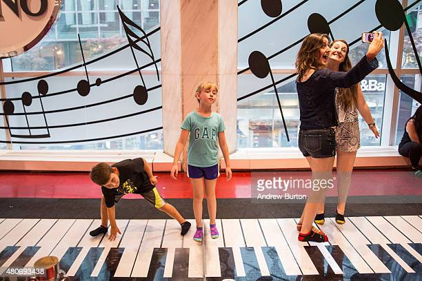Children play on the 'Big Piano' made famous by the movie Big in FAO Schwarz toy store on July 14 2015 in New York City The famed toy store will...