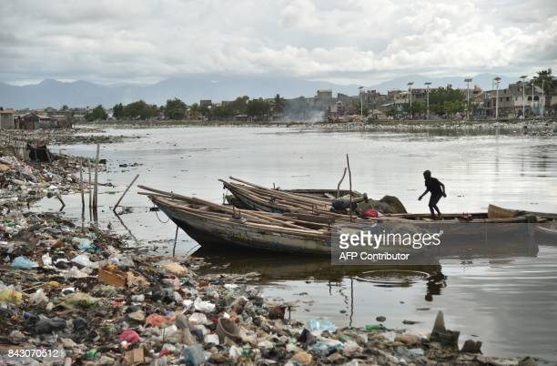 Children play on the boats in Mapou River in CapHaitien in the north of Haiti 240 km from PortauPrince ahead of Hurricane Irma on September 5 2017...