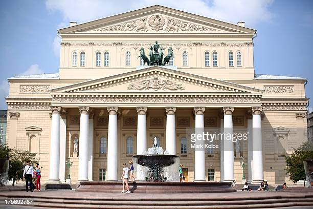 Children play on the fountain in front of the the Bolshoi Theatre ahead of the IAAF World Championships on August 6 2013 in Moscow Russia